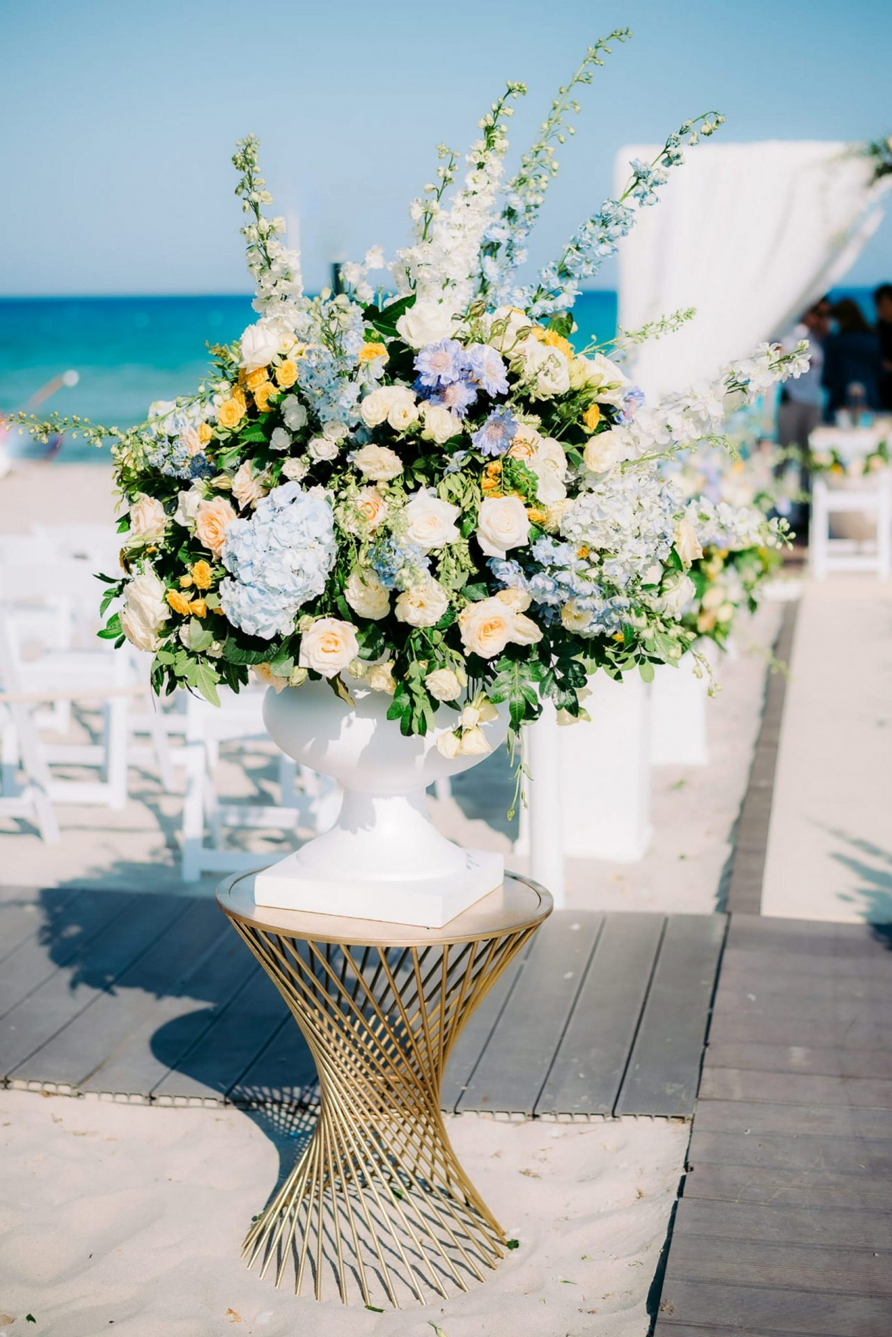 Linda and Enrico, blue and yellow flowers decor on the beach