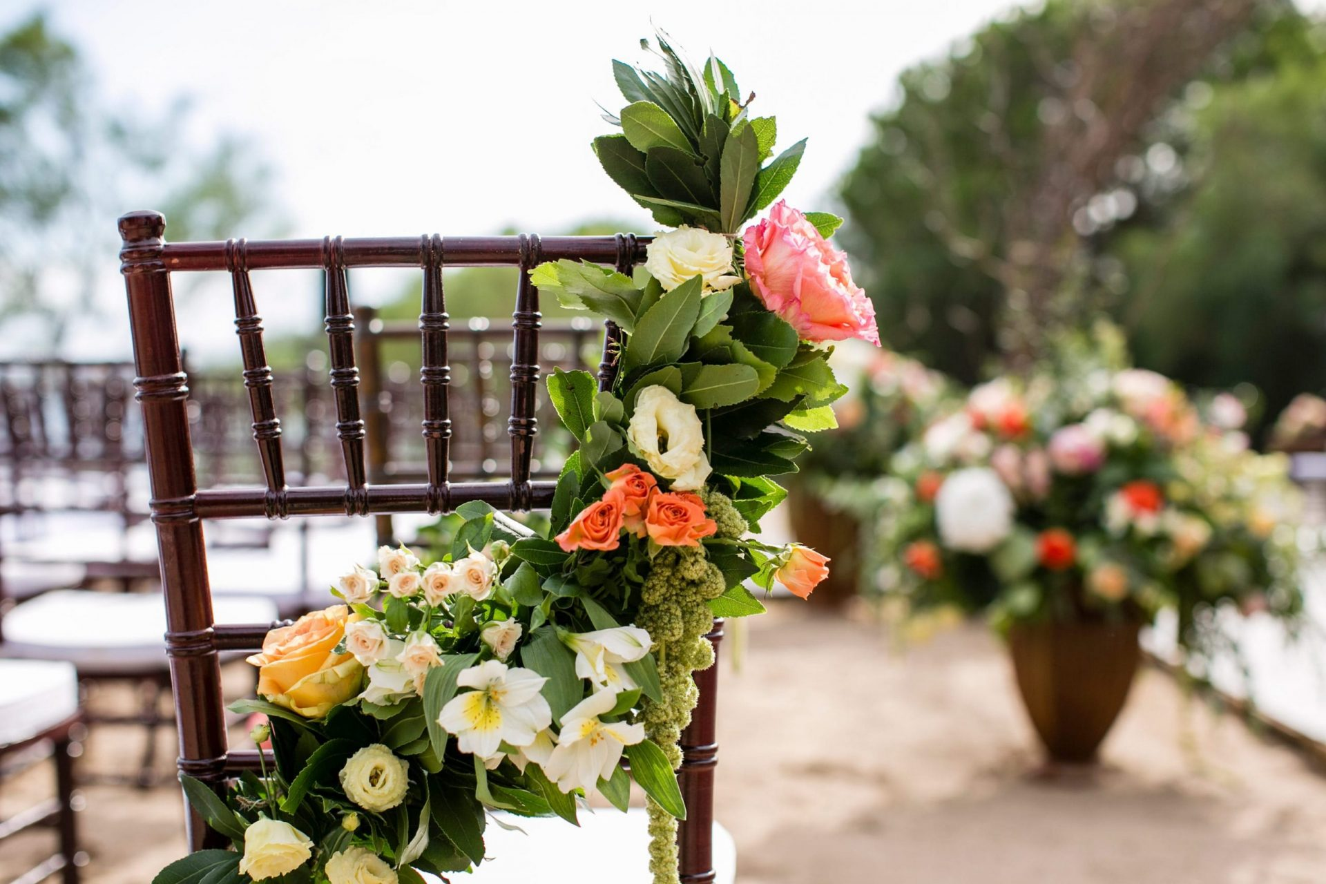 Lisa and Daniel, luxury wedding in Cala di Volpe, ceremony chair decoration