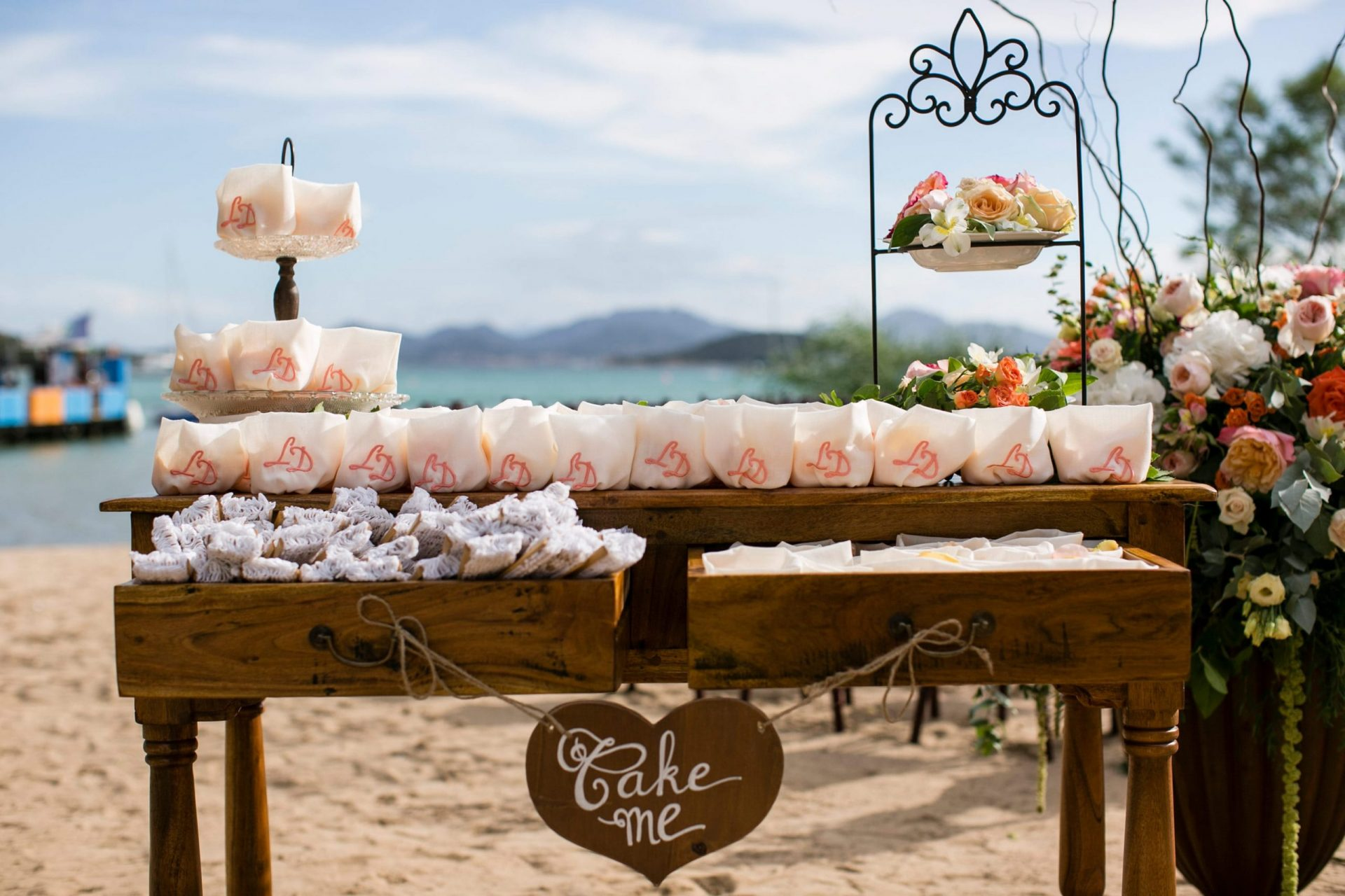 Lisa and Daniel, luxury wedding in Cala di Volpe, ceremony accessories station
