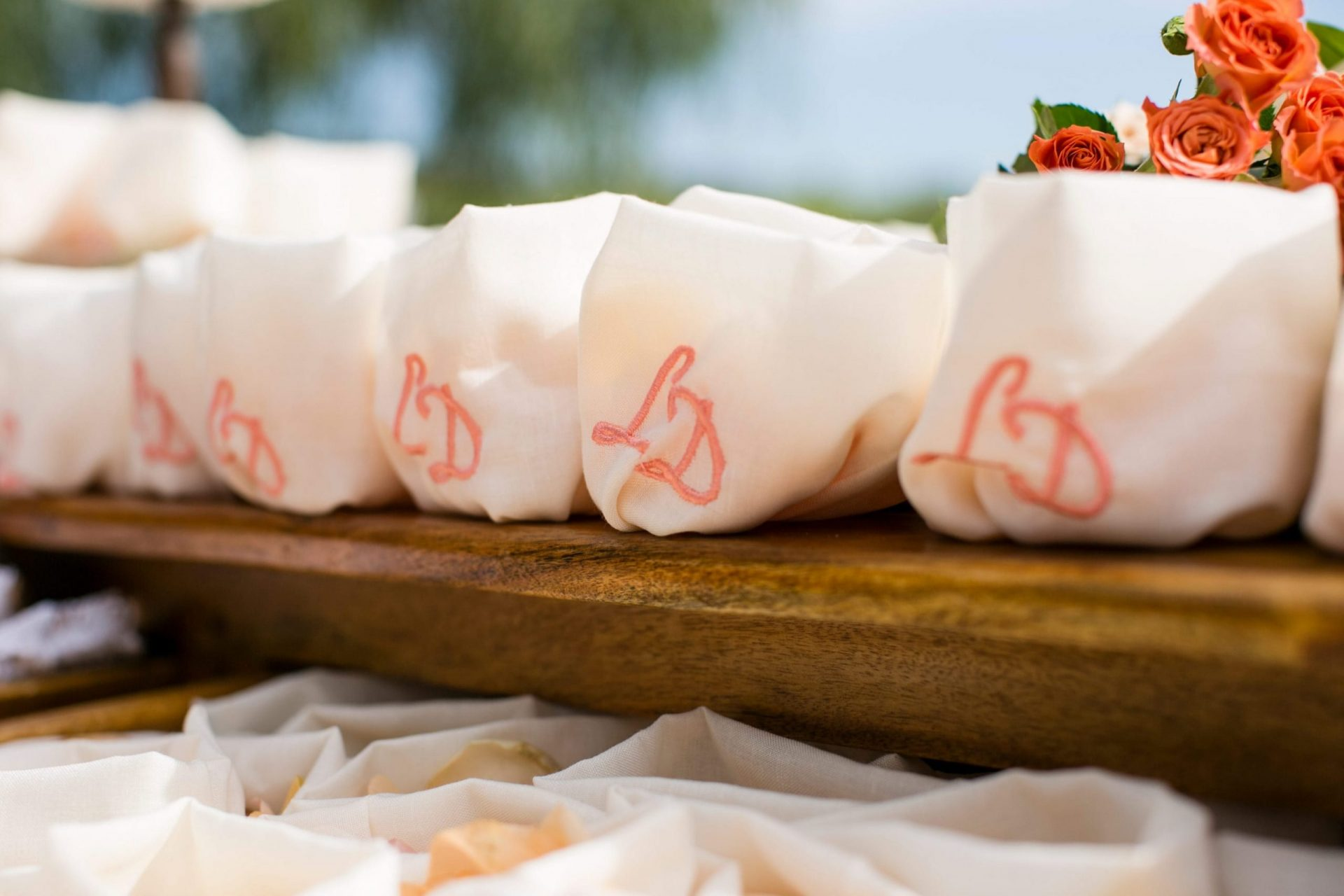 Lisa and Daniel, luxury wedding in Cala di Volpe, embroidered initials on petals sachet