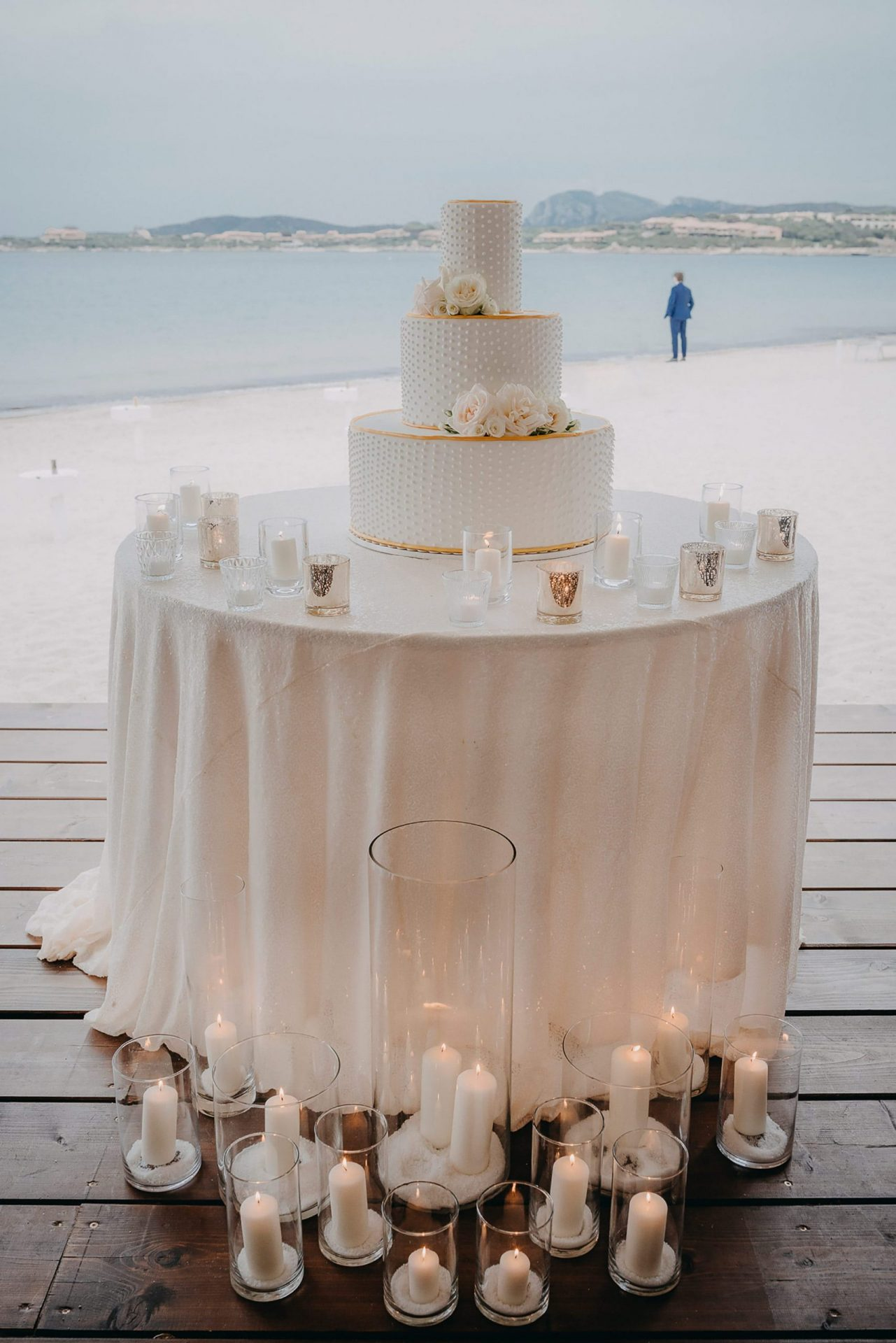 Luca and Anj, the wedding cake table by the beach