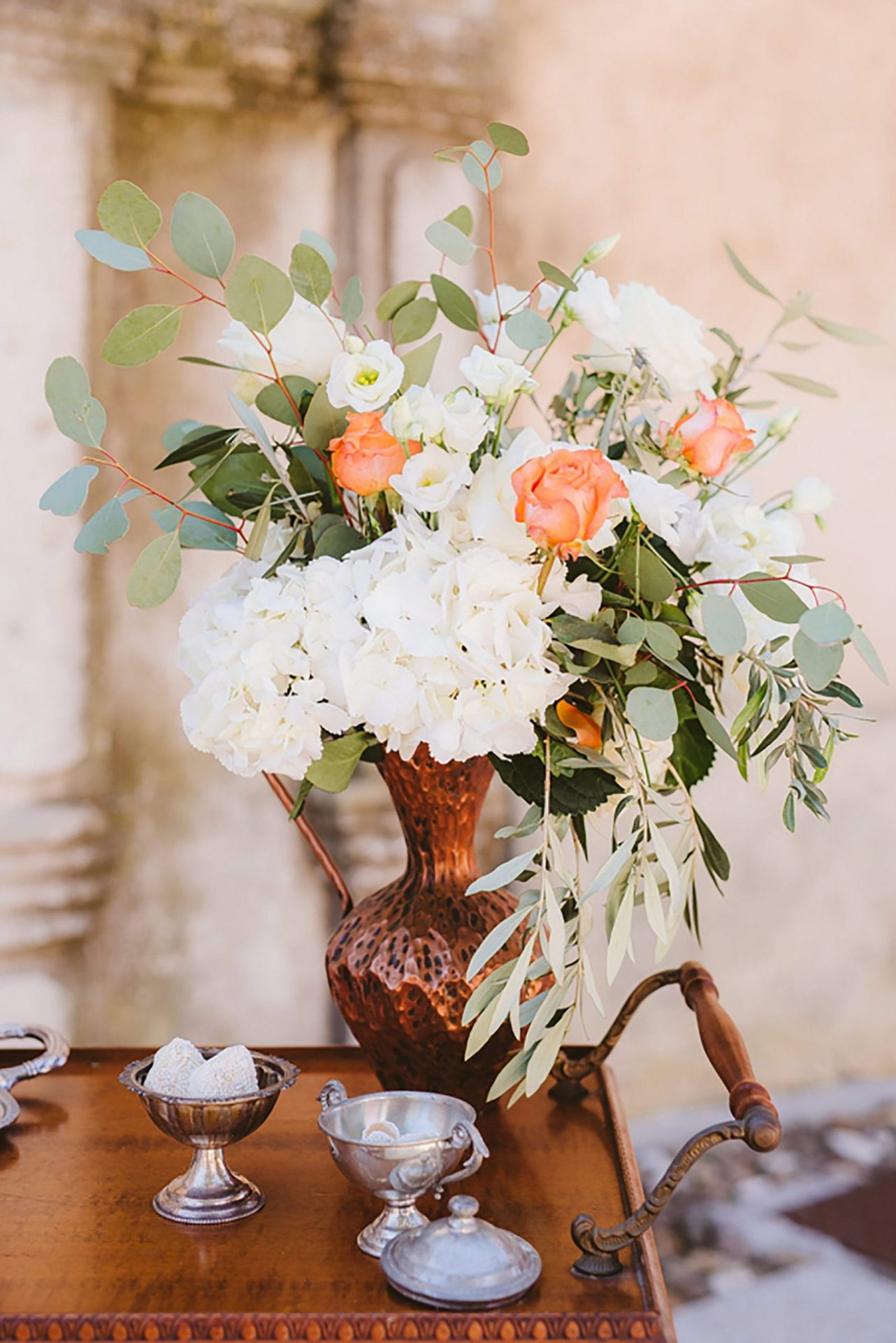 Elopement in ancient Italian village. flower decor